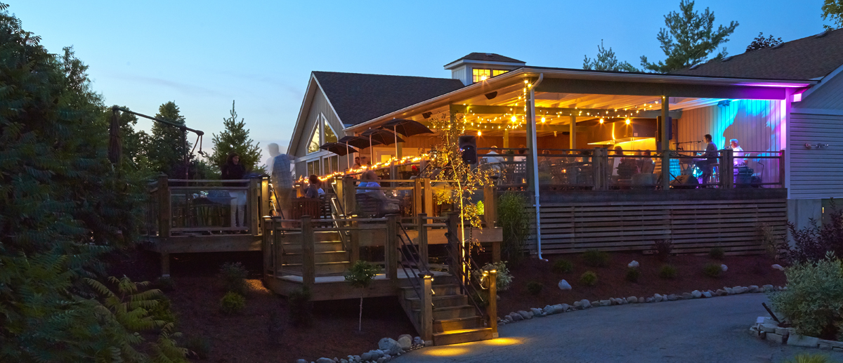 the patio behind the creekside estates winery tasting room
