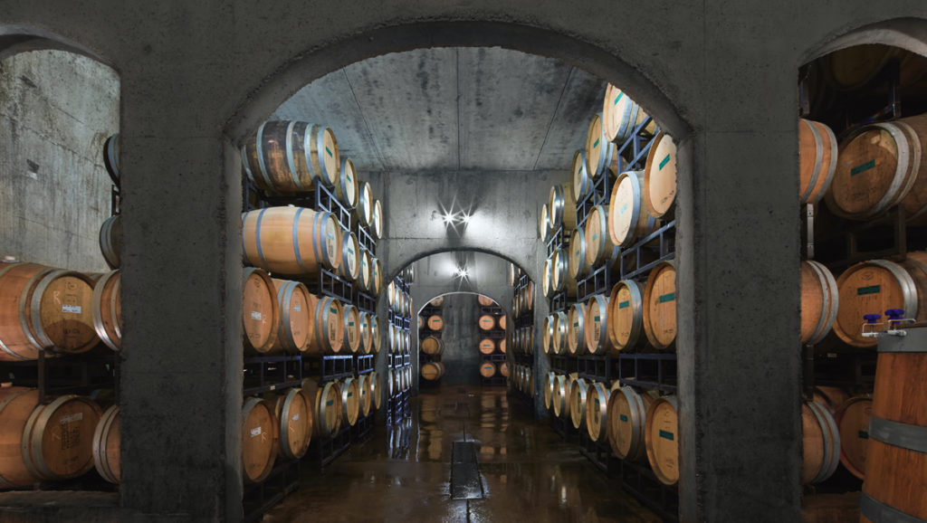 creekside estates winery cellar with barrels